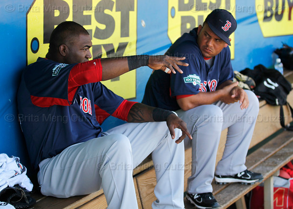 FORT MYERS, FL, March 30, 2012: Boston Red Sox designated hitter David Ortiz, left, talks with Red Sox minor leaguer Mauro Gomez in the dugout during the first inning of a Grapefruit League spring training game against the Minnesota Twins at Hammond Stadium. (Brita Meng Outzen/Boston Red Sox)