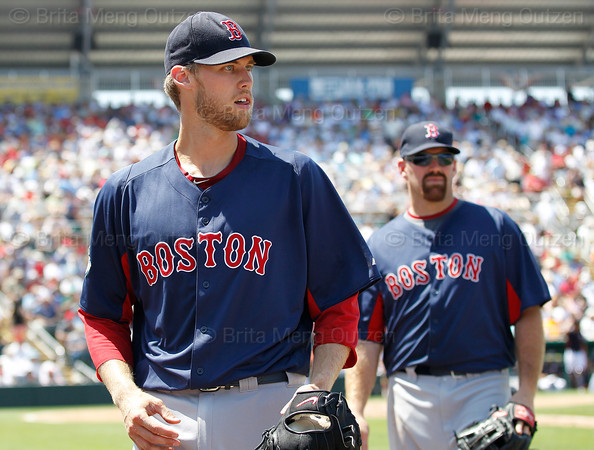 FORT MYERS, FL, March 30, 2012: Boston Red Sox pitcher Daniel Bard, left, and third baseman Kevin Youkilis walk back to the dugout after the fourth inning of a Grapefruit League spring training game against the Minnesota Twins at Hammond Stadium. (Brita Meng Outzen/Boston Red Sox)