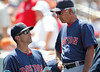 FORT MYERS, FL, March 30, 2012: Boston Red Sox manager Bobby Valentine, right, and bench coach Tim Bogar discuss defensive changes for the team in the dugout during the sixth inning of a Grapefruit League spring training game against the Minnesota Twins at Hammond Stadium. (Brita Meng Outzen/Boston Red Sox)