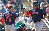 FORT MYERS, FL, March 30, 2012: Boston Red Sox batter Mauro Gomez, right, is congratulated by teammate Nate Spears after hitting a two-run home run off Minnesota Twins pitcher Brian Duensing in the eighth inning of a Grapefruit League spring training game at Hammond Stadium. (Brita Meng Outzen/Boston Red Sox)