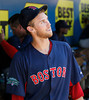 FORT MYERS, FL, March 30, 2012: Boston Red Sox pitcher Daniel Bard smiles at a teammate after returning to the dugout following a 1-2-3 third inning against the Minnesota Twins in a Grapefruit League spring training game at Hammond Stadium. (Brita Meng Outzen/Boston Red Sox)