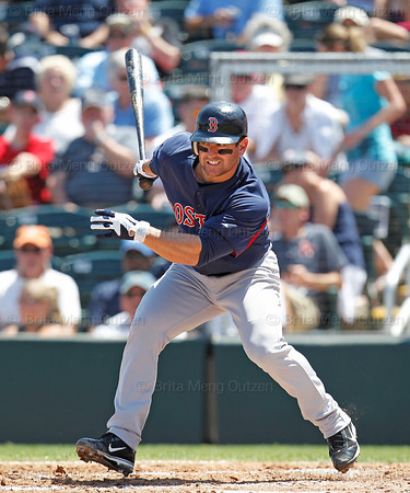 FORT MYERS, FL, March 30, 2012: Boston Red Sox batter Nick Punto follows through on a swing at a baseball thrown by Minnesota Twins pitcher Nick Blackburn in the third inning of a Grapefruit League spring training game at Hammond Stadium. (Brita Meng Outzen/Boston Red Sox)