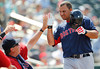 FORT MYERS, FL, March 30, 2012: Boston Red Sox batter Mauro Gomez, right, is congratulated by hitting coach Dave Magadan at the dugout after hitting a two-run home run off Minnesota Twins pitcher Brian Duensing in the eighth inning of a Grapefruit League spring training game at Hammond Stadium. (Brita Meng Outzen/Boston Red Sox)