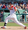 FORT MYERS, FL, March 4, 2012: Boston Red Sox batter Juan Carlos Linares hits a broken bat single off Minnesota Twins pitcher Esmerling Vasquez in the fifth inning of a Grapefruit League game at JetBlue Park at Fenway South. (Brita Meng Outzen/Boston Red Sox)