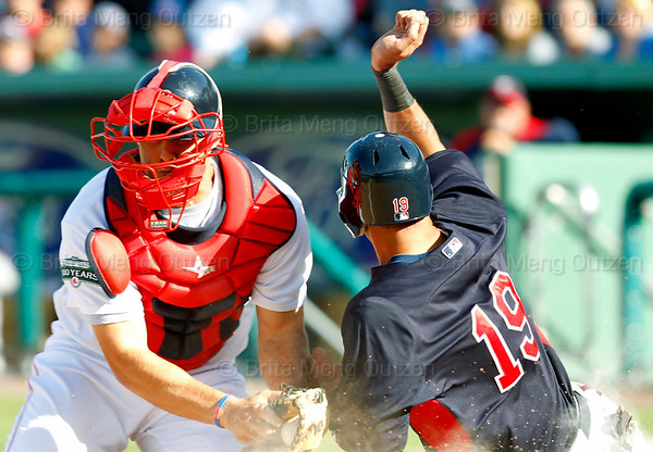 FORT MYERS, FL, March 4, 2012: Boston Red Sox catcher Ryan Lavarnway, left, tags out Minnesota Twins base runner Darin Mastroianni trying to steal home in the seventh inning of a Grapefruit League game at JetBlue Park at Fenway South. (Brita Meng Outzen/Boston Red Sox)