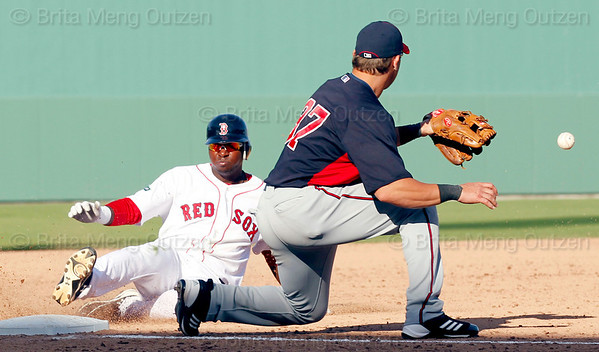 FORT MYERS, FL, March 4, 2012: Boston Red Sox batter Oscar Tejeda, right, slides into third base with a triple as Minnesota Twins third baseman Sean Burroughs waits for the baseball in the eighth inning of a Grapefruit League game at JetBlue Park at Fenway South. (Brita Meng Outzen/Boston Red Sox)