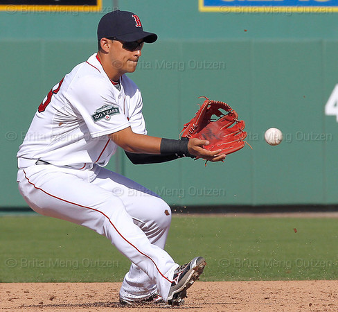 FORT MYERS, FL, March 4, 2012: Boston Red Sox shortstop Jose Iglesias fields a baseball hit by Minnesota Twins batter Darin Mastroianni in the seventh inning of a Grapefruit League game at JetBlue Park at Fenway South. (Brita Meng Outzen/Boston Red Sox)