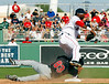 FORT MYERS, FL, March 4, 2012: Boston Red Sox second baseman Oscar Tejeda, right, appears to land on Minnesota Twins base runner Ray Chang at second base after throwing to first base for an attempted double play in the seventh inning of a a Grapefruit League game at JetBlue Park at Fenway South. (Brita Meng Outzen/Boston Red Sox)