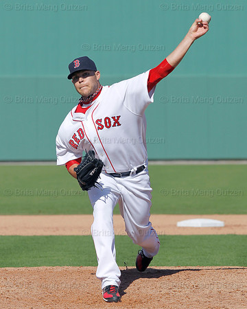 FORT MYERS, FL, March 4, 2012: Boston Red Sox pitcher Justin Thomas throws a warmup pitch before the sixth inning of a Grapefruit League game against the Minnesota Twins at JetBlue Park at Fenway South. (Brita Meng Outzen/Boston Red Sox)