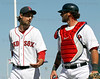 FORT MYERS, FL, March 4, 2012: Boston Red Sox pitcher Andrew Miller, left, and catcher Jarrod Saltalamacchia talk as they walk back to the dugout after the fourth inning of a Grapefruit League game against the Minnesota Twins at JetBlue Park at Fenway South. (Brita Meng Outzen/Boston Red Sox)
