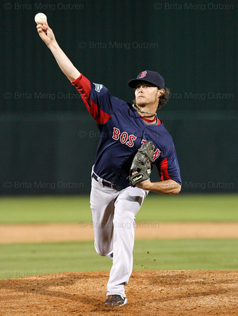 FORT MYERS, FL, March 5, 2012: Boston Red Sox pitcher Clay Buchholz throws a warmup pitch before the first inning of a Grapefruit League game against the Minnesota Twins at Hammond Stadium. (Brita Meng Outzen/Boston Red Sox)