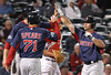 FORT MYERS, FL, March 5, 2012: Boston Red Sox batter Daniel Butler, right, is congratulated by teammates Lars Anderson, left, and Nate Spears after hitting a three-run home run off Minnesota Twins pitcher Deolis Guerra in the seventh inning of a Grapefruit League game at Hammond Stadium. (Brita Meng Outzen/Boston Red Sox)