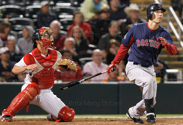 FORT MYERS, FL, March 5, 2012: Boston Red Sox batter Nate Spears, right, and Minnesota Twins catcher Dan Rohlfing watch Spears' ground rule double in the seventh inning of a Grapefruit League game at Hammond Stadium. (Brita Meng Outzen/Boston Red Sox)