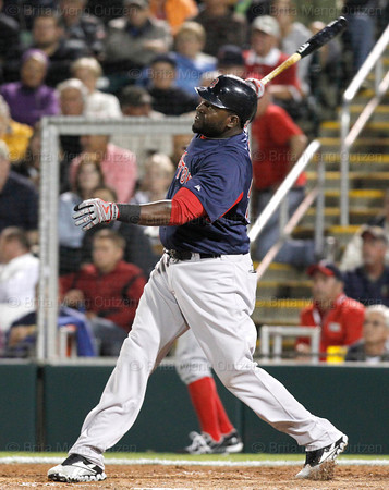 FORT MYERS, FL, March 5, 2012: Boston Red Sox batter David Ortiz hits his first home run of the spring, a solo shot off Minnesota Twins pitcher Jason Marquis in the third inning of a Grapefruit League game at Hammond Stadium. (Brita Meng Outzen/Boston Red Sox)