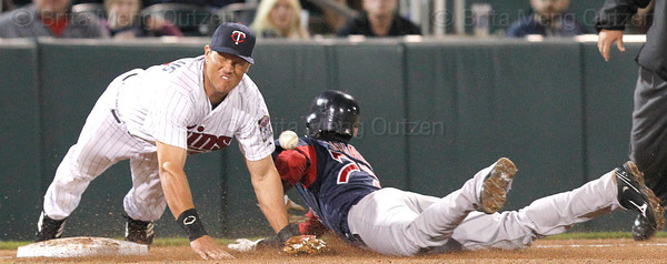 FORT MYERS, FL, March 5, 2012: Minnesota Twins third baseman Sean Burroughs can't come up with the baseball as Boston Red Sox batter Pedro Ciriaco steals third base in the seventh inning of a Grapefruit League game at Hammond Stadium. (Brita Meng Outzen/Boston Red Sox)