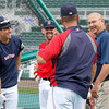 FORT MYERS, FL, March 22, 2012: Former Boston Red Sox manager and current ESPN baseball analyst Terry Francona, right, talks on the field with, from left, Red Sox center fielder Jacoby Ellsbury, third baseman Kevin Youkilis and bench coach Tim Bogar during batting practice before a Grapefruit League spring training game against the New York Yankees at JetBlue Park at Fenway South. (Brita Meng Outzen/Boston Red Sox)