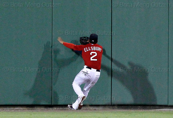 FORT MYERS, FL, March 22, 2012: Boston Red Sox center fielder Jacoby Ellsbury prepares to run into the padded wall while chasing a triple off the bat of New York Yankees batter Curtis Granderson in the fourth inning of a Grapefruit League spring training game at JetBlue Park at Fenway South. (Brita Meng Outzen/Boston Red Sox)