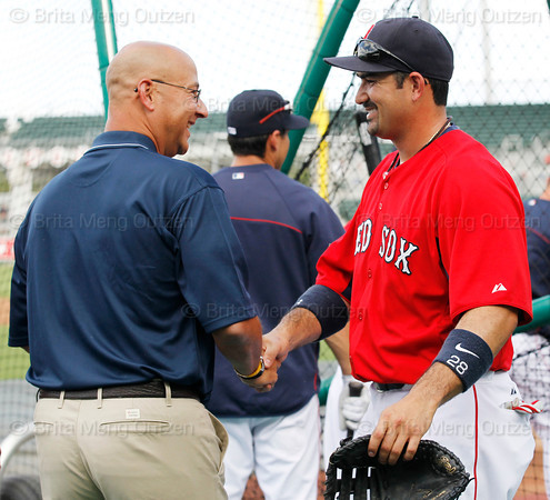 FORT MYERS, FL, March 22, 2012: Former Boston Red Sox manager and current ESPN baseball analyst Terry Francona, left, shakes hands with Red Sox first baseman Adrian Gonzalez during batting practice before a Grapefruit League spring training game against the New York Yankees at JetBlue Park at Fenway South. (Brita Meng Outzen/Boston Red Sox)