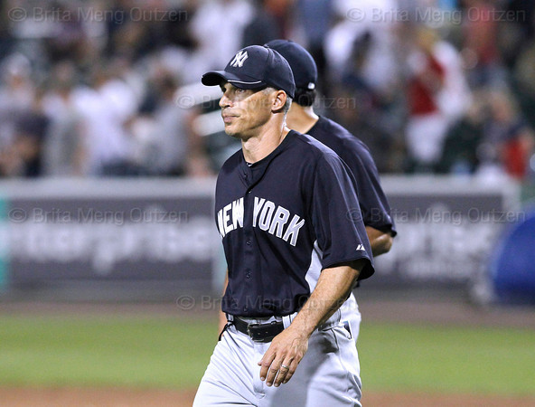 FORT MYERS, FL, March 22, 2012: New York Yankees manager Joe Girardi leads his team off the field at the end of the ninth inning of a 4-4 Grapefruit League spring training game against the Boston Red Sox at JetBlue Park at Fenway South. Girardi informed umpires he was out of pitchers and could not play the 10th inning even though Red Sox pitcher Clayton Mortensen was warmed up and ready to pitch the top of the 10th inning. (Brita Meng Outzen/Boston Red Sox)