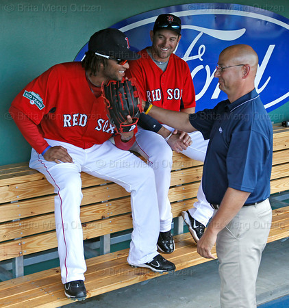 FORT MYERS, FL, March 22, 2012: Former Boston Red Sox manager and current ESPN baseball analyst Terry Francona, right, talks with Red Sox outfielder Darnell McDonald, left, and infielder Nick Punto in the dugout during batting practice before a Grapefruit League spring training game against the New York Yankees at JetBlue Park at Fenway South. (Brita Meng Outzen/Boston Red Sox)