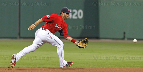 FORT MYERS, FL, March 22, 2012: Boston Red Sox shortstop Mike Aviles prepares to field a ground ball hit by New York Yankees batter Ramiro Pena in the third inning of a Grapefruit League spring training game at JetBlue Park at Fenway South. (Brita Meng Outzen/Boston Red Sox)