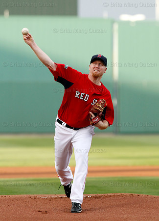 FORT MYERS, FL, March 22, 2012: Boston Red Sox pitcher Aaron Cook throws a warmup pitch before the first inning of a Grapefruit League spring training game against the New York Yankees at JetBlue Park at Fenway South. (Brita Meng Outzen/Boston Red Sox)