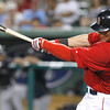 FORT MYERS, FL, March 22, 2012: Boston Red Sox batter Ryan Sweeney hits a single off New York Yankees pitcher Juan Cedeno in the ninth inning of a Grapefruit League spring training game at JetBlue Park at Fenway South. (Brita Meng Outzen/Boston Red Sox)
