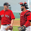 FORT MYERS, FL, March 22, 2012: Boston Red Sox pitcher Aaron Cook, left, and catcher Kelly Shoppach talk as they walk back to the dugout after the top half of the second inning of a Grapefruit League spring training game against the New York Yankees at JetBlue Park at Fenway South. (Brita Meng Outzen/Boston Red Sox)
