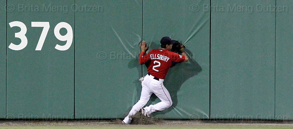 FORT MYERS, FL, March 22, 2012: Boston Red Sox center fielder Jacoby Ellsbury runs into the padded wall while chasing a triple off the bat of New York Yankees batter Curtis Granderson in the fourth inning of a Grapefruit League spring training game at JetBlue Park at Fenway South. (Brita Meng Outzen/Boston Red Sox)