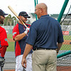 FORT MYERS, FL, March 22, 2012: Former Boston Red Sox manager and current ESPN baseball analyst Terry Francona, second from right, talks on the field with, from left, Red Sox second baseman Dustin Pedroia, left fielder Cody Ross and third baseman Kevin Youkilis during batting practice before a Grapefruit League spring training game against the New York Yankees at JetBlue Park at Fenway South. (Brita Meng Outzen/Boston Red Sox)