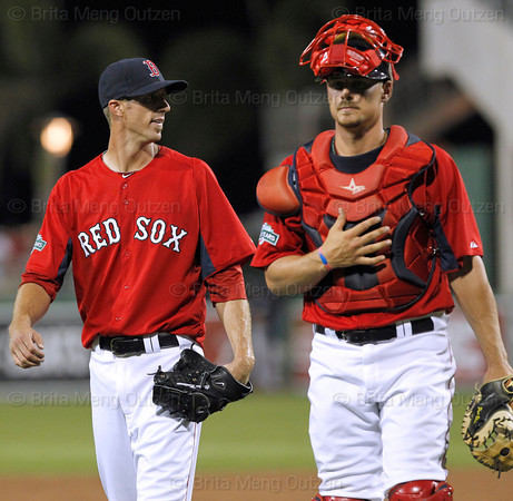 FORT MYERS, FL, March 22, 2012: Boston Red Sox pitcher Clayton Mortensen, left, and catcher Ryan Lavarnway walk off the pitcher's mound as the Grapefruit League spring training game against the New York Yankees comes to an end with the score 4-4 after nine innings at JetBlue Park at Fenway South. Yankees manager Joe Girardi informed umpires he was out of pitchers and could not play the 10th inning even though Mortensen was warmed up and ready to pitch. (Brita Meng Outzen/Boston Red Sox)
