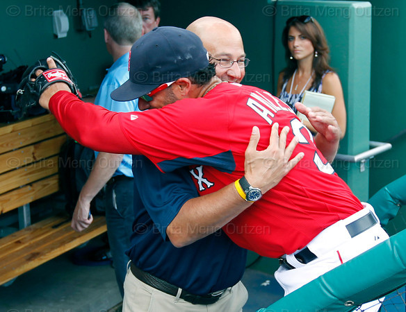 FORT MYERS, FL, March 22, 2012: Former Boston Red Sox manager and current ESPN baseball analyst Terry Francona, left, hugs Red Sox shortstop Mike Aviles during batting practice before a Grapefruit League spring training game against the New York Yankees at JetBlue Park at Fenway South. (Brita Meng Outzen/Boston Red Sox)