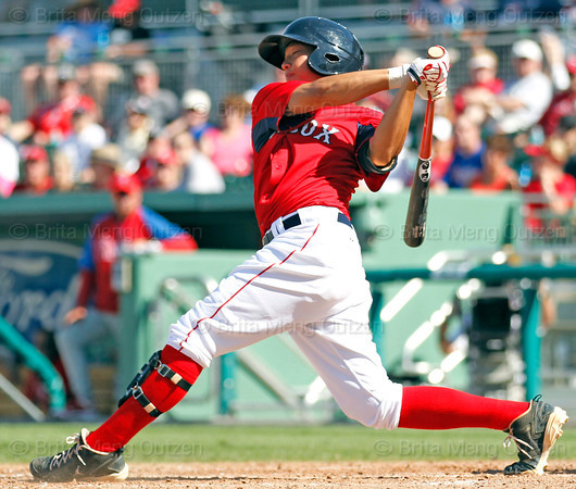 FORT MYERS, FL, March 24, 2012: Boston Red Sox batter Jonathan Hee singles off Philadelphia Phillies pitcher Brian Sanches in the eight inning of a Grapefruit League spring training game at JetBlue Park at Fenway South. (Brita Meng Outzen/Boston Red Sox)