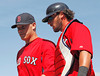 FORT MYERS, FL, March 24, 2012: Boston Red Sox pitcher Andrew Bailey, left, and catcher Jarrod Saltalamacchia talk as they walk back to the dugout after Bailey pitches a scoreless seventh inning in a Grapefruit League spring training game against the Philadelphia Phillies at JetBlue Park at Fenway South. (Brita Meng Outzen/Boston Red Sox)