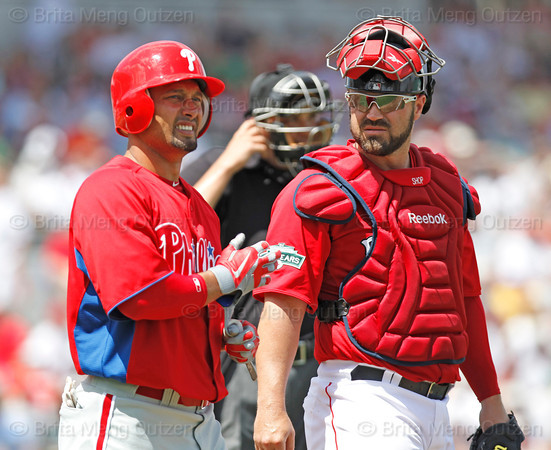 FORT MYERS, FL, March 24, 2012:  Boston Red Sox catcher Kelly Shoppach, right, checks on Philadelphia Phillies batter Shane Victorino after Victorino was hit by a pitch thrown by Red Sox pitcher Alfredo Aceves in the second inning of a Grapefruit League spring training game at JetBlue Park at Fenway South. (Brita Meng Outzen/Boston Red Sox)