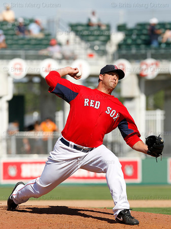 FORT MYERS, FL, March 24, 2012: Boston Red Sox pitcher Garrett Mock throws a pitch to a Philadelphia Phillies batter in the ninth inning of a Grapefruit League spring training game at JetBlue Park at Fenway South. (Brita Meng Outzen/Boston Red Sox)
