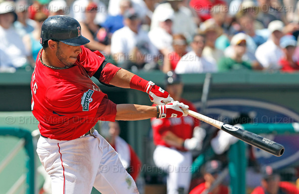 FORT MYERS, FL, March 24, 2012: Boston Red Sox batter Mike Aviles hits a double off Philadelphia Phillies pitcher Cole Hamels in the fourth inning of a Grapefruit League spring training game at JetBlue Park at Fenway South. (Brita Meng Outzen/Boston Red Sox)