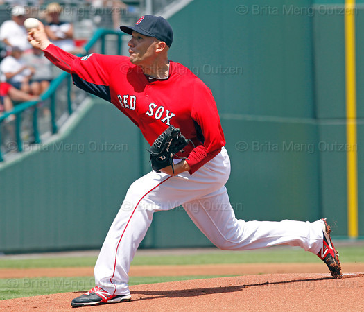 FORT MYERS, FL, March 24, 2012: Boston Red Sox pitcher Alfredo Aceves throws a pitch to a Philadelphia Phillies batter in the first inning of a Grapefruit League spring training game at JetBlue Park at Fenway South. (Brita Meng Outzen/Boston Red Sox)