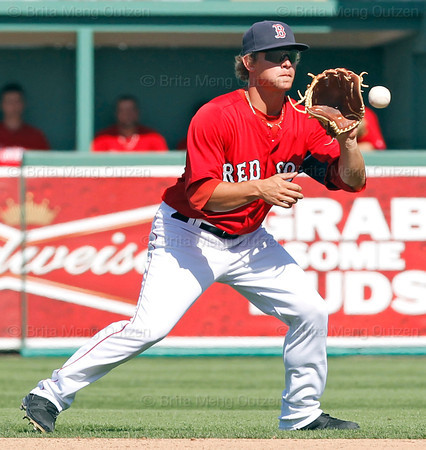 FORT MYERS, FL, March 24, 2012: Boston Red Sox second baseman Zach Gentile fields a baseball hit by Philadelphia Phillies batter Scott Posednik in the eighth inning of a Grapefruit League spring training game at JetBlue Park at Fenway South. (Brita Meng Outzen/Boston Red Sox)