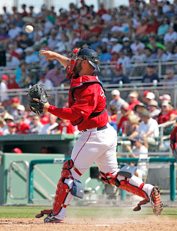 FORT MYERS, FL, March 24, 2012: Boston Red Sox catcher Kelly Shoppach throws the baseball back to pitcher Franklin Morales in the sixth inning of a Grapefruit League spring training game against the Philadelphia Phillies at JetBlue Park at Fenway South. (Brita Meng Outzen/Boston Red Sox)
