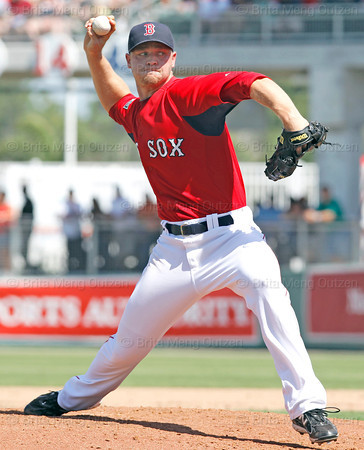 FORT MYERS, FL, March 24, 2012: Boston Red Sox pitcher Michael Bowden throws a pitch to a Philadelphia Phillies batter in the fifth inning of a Grapefruit League spring training game at JetBlue Park at Fenway South. (Brita Meng Outzen/Boston Red Sox)