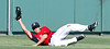 FORT MYERS, FL, March 24, 2012: Boston Red Sox center fielder Peter Hissey slides on the grass as he holds up his glove following a catch of a fly ball hit by Philadelphia Phillies batter Hector Luna in the ninth inning of a Grapefruit League spring training game at JetBlue Park at Fenway South. (Brita Meng Outzen/Boston Red Sox)
