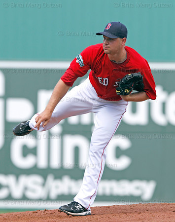 FORT MYERS, FL, March 24, 2012: Boston Red Sox pitcher Michael Bowden follows through on a pitch to a Philadelphia Phillies batter in the fourth inning of a Grapefruit League spring training game at JetBlue Park at Fenway South. (Brita Meng Outzen/Boston Red Sox)