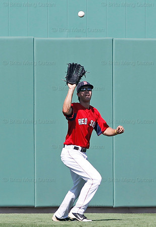 FORT MYERS, FL, March 24, 2012: Boston Red Sox center fielder Peter Hissey catches a fly ball hit by Philadelphia Phillies batter Tim Kennelly in the eighth inning of a Grapefruit League spring training game at JetBlue Park at Fenway South. (Brita Meng Outzen/Boston Red Sox)