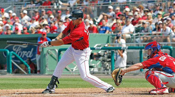 FORT MYERS, FL, March 24, 2012:  Boston Red Sox batter Josh Kroeger hits an RBI single off Philadelphia Phillies pitcher Raul Valdes in the sixth inning of a Grapefruit League spring training game at JetBlue Park at Fenway South. (Brita Meng Outzen/Boston Red Sox)
