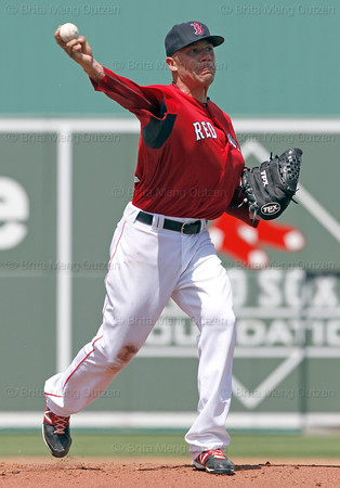 FORT MYERS, FL, March 24, 2012: Boston Red Sox pitcher Alfredo Aceves makes a pickoff throw to first base in the second inning of a Grapefruit League spring training game against the Philadelphia Phillies at JetBlue Park at Fenway South. (Brita Meng Outzen/Boston Red Sox)
