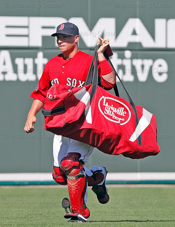 FORT MYERS, FL, March 24, 2012: Boston Red Sox catcher Christian Vazquez trots to the dugout from the bullpen with his equipment bag in before the bottom half of the eighth inning of a Grapefruit League spring training game against the Philadelphia Phillies at JetBlue Park at Fenway South. (Brita Meng Outzen/Boston Red Sox)