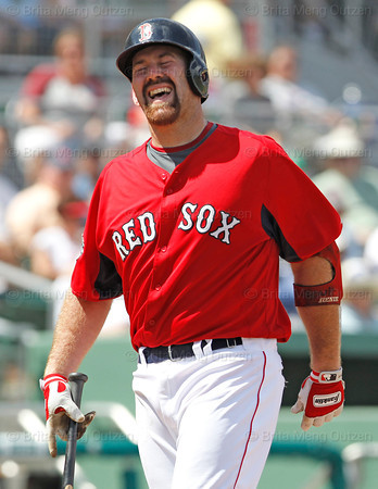 FORT MYERS, FL, March 24, 2012: Boston Red Sox batter Kevin Youkilis reacts after swinging and missing at a pitch from Philadelphia Phillies pitcher Cole Hamels in the third inning of a Grapefruit League spring training game at JetBlue Park at Fenway South. (Brita Meng Outzen/Boston Red Sox)
