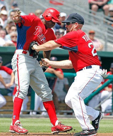 FORT MYERS, FL, March 24, 2012: Boston Red Sox third baseman Kevin Youkilis, right, tags out Philadelphia Phillies base runner Juan Pierre during a rundown in the first inning of a a Grapefruit League spring training game at JetBlue Park at Fenway South. (Brita Meng Outzen/Boston Red Sox)