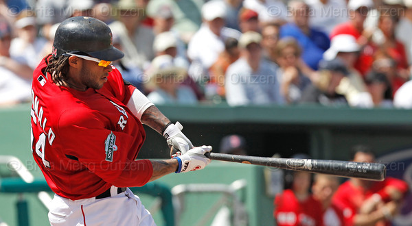 FORT MYERS, FL, March 24, 2012: Boston Red Sox batter Darnell McDonald hits a single off Philadelphia Phillies pitcher Cole Hamels in the third inning of a Grapefruit League spring training game at JetBlue Park at Fenway South. (Brita Meng Outzen/Boston Red Sox)